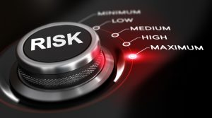 Switch button positioned on the word maximum, black background and red light. Conceptual image for illustration of high level of risks.